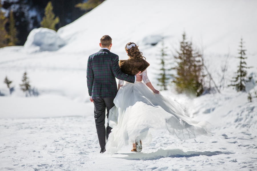 bride and groom walking at deer lodge wedding