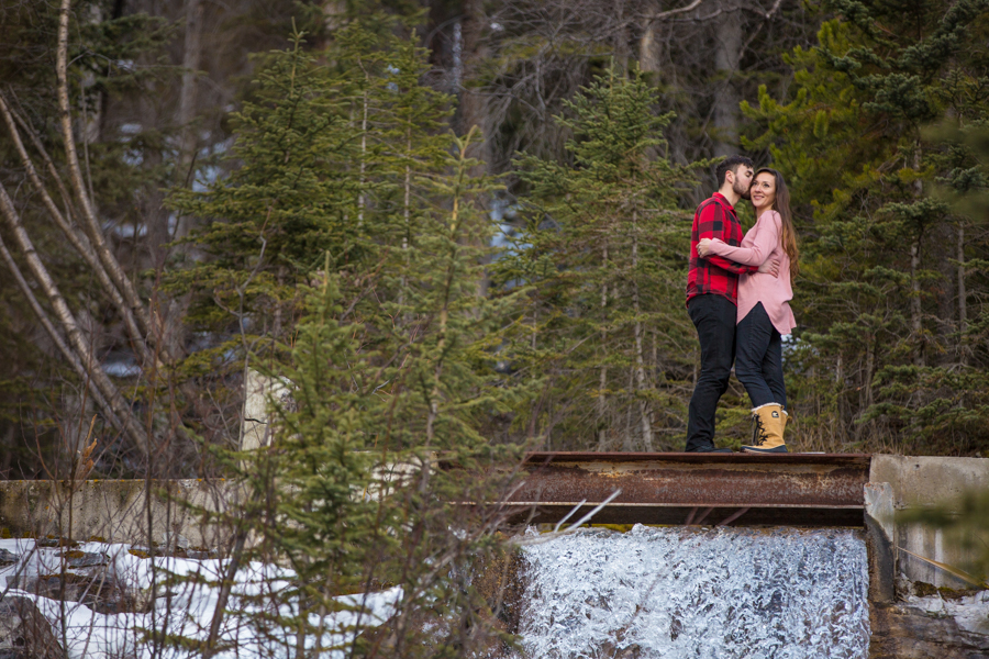 couple next to a water fall at grass lakes