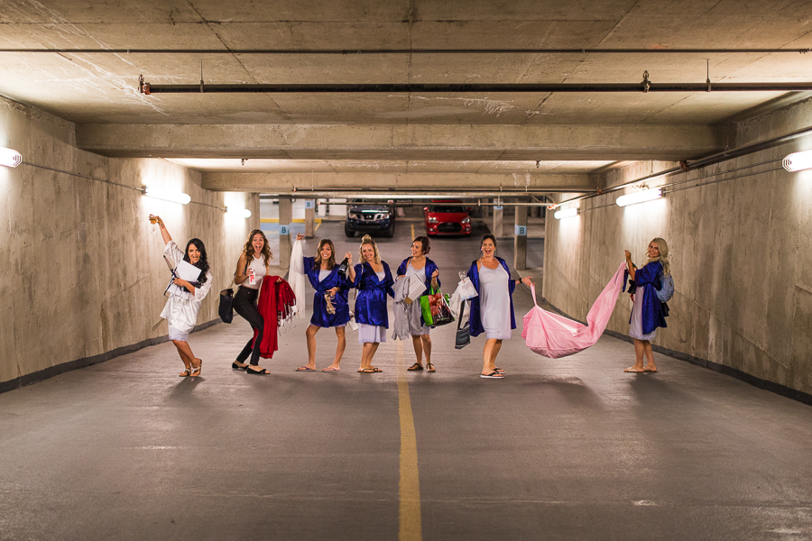 bridesmaids, getting ready, group picture in a parkade