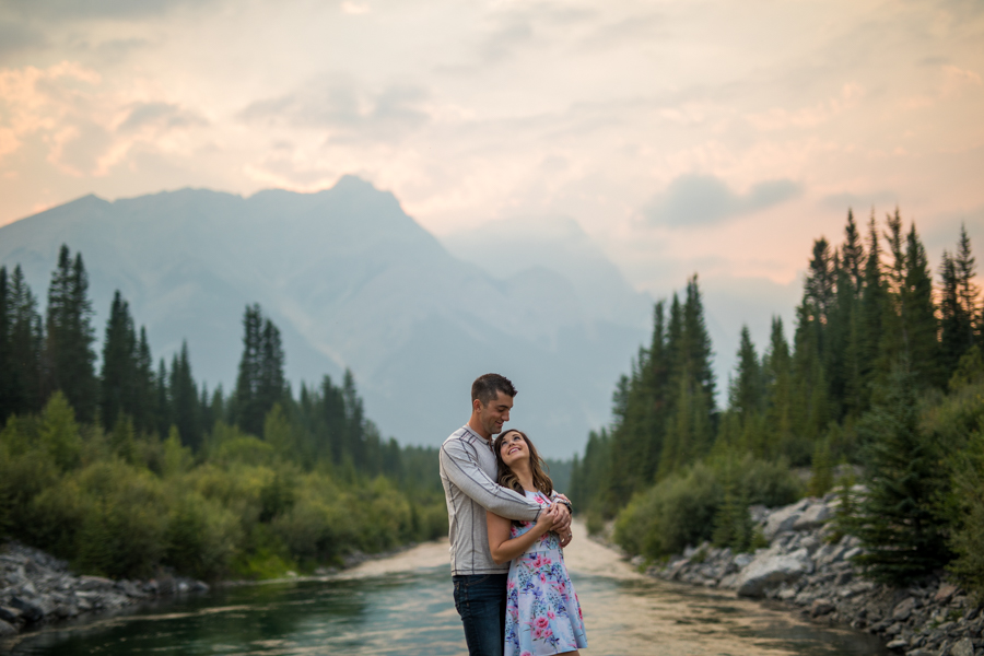 engagment session in the mountains, couple in front of a river, sunset engagement session