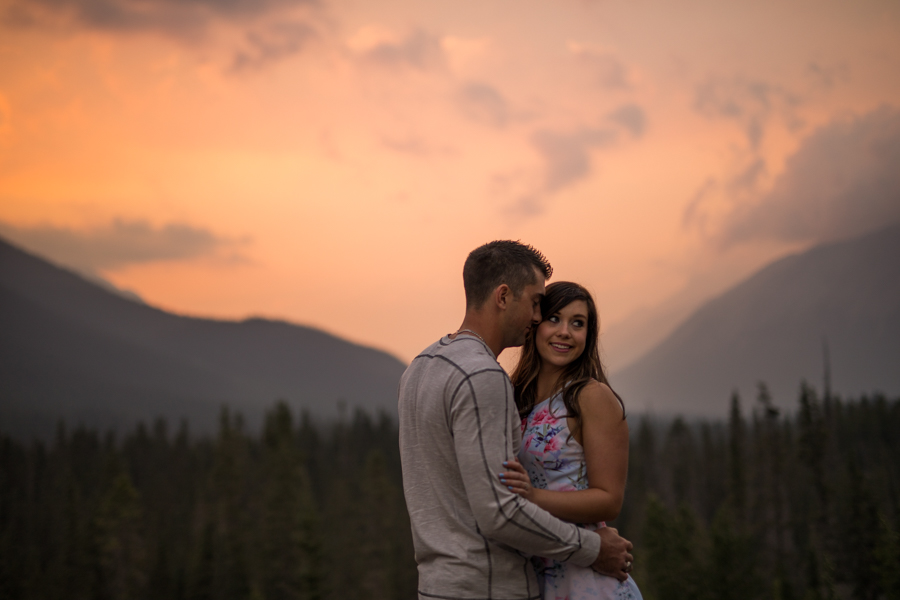 canmore engagement, canmore alberta, Alberta rocky mountains, engagement in Canmore, red sunset engagement, kisses in the ear