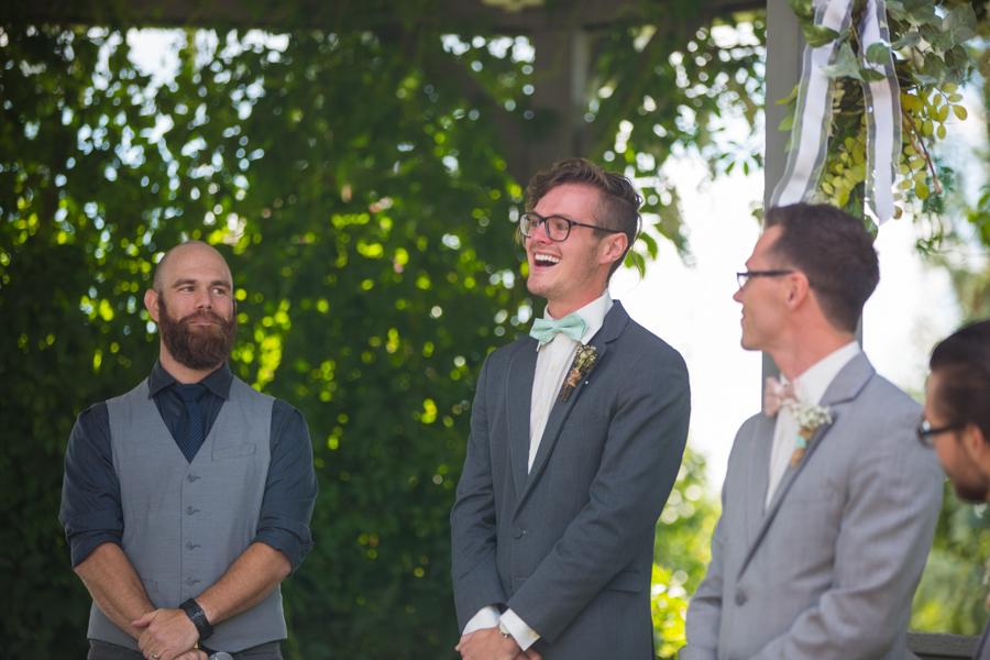 groom overjoyed at first look. first look, hastings lake gardens