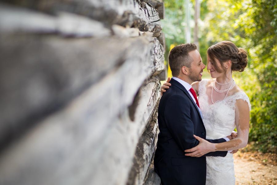 Bride and groom kiss at the nut farm, wedding in kelowna, kelowna bc, kelowna wedding photographer, amazing kelowna wedding, award winning kelowna photographers