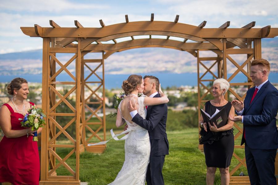 Bride and groom kiss at the nut farm, wedding in kelowna, kelowna bc, kelowna wedding photographer, amazing kelowna wedding, award winning kelowna photographers, off the grid organic winery