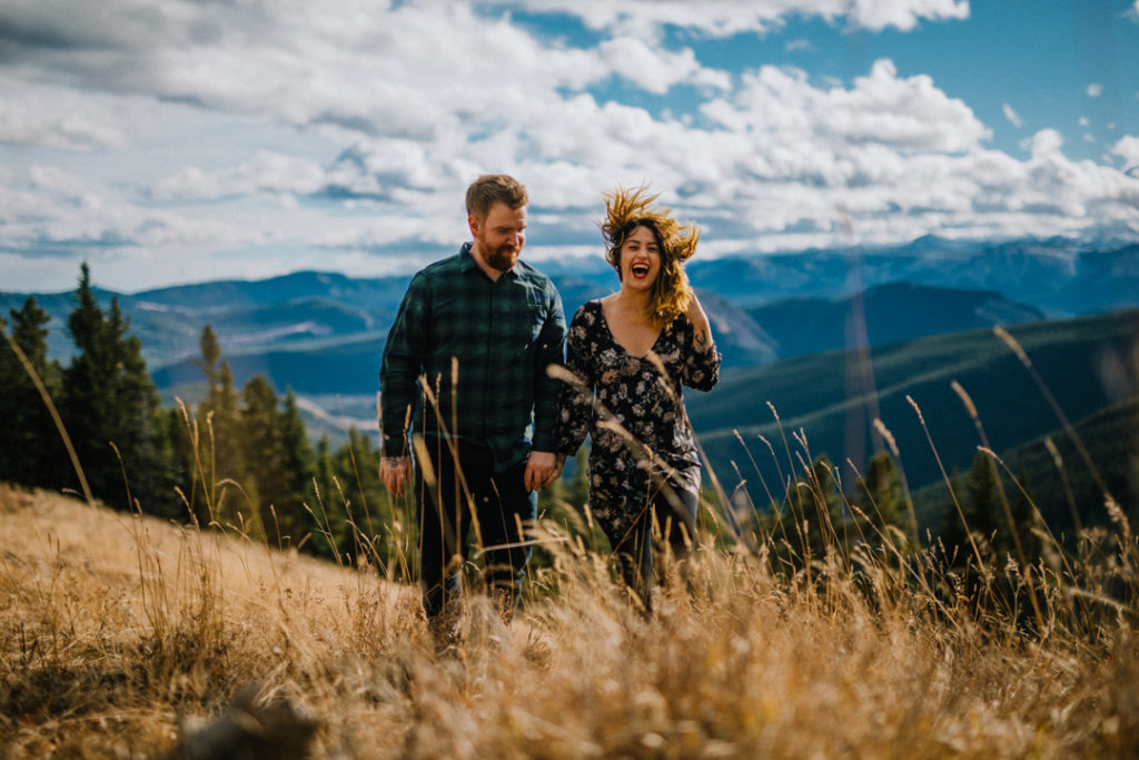puppy, bragg creek, river, engagement, bragg creek engagement, love in the mountains, rockies engagement, windy, dirty boots messy hair, kiss