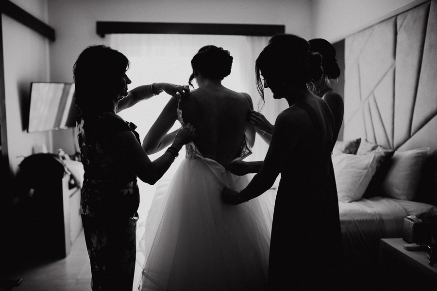 bride getting into her dress, destination wedding