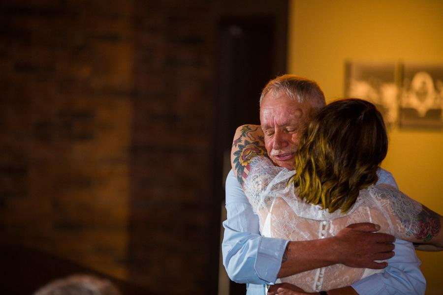 bride hugging her grandfather in the Baron event venue
