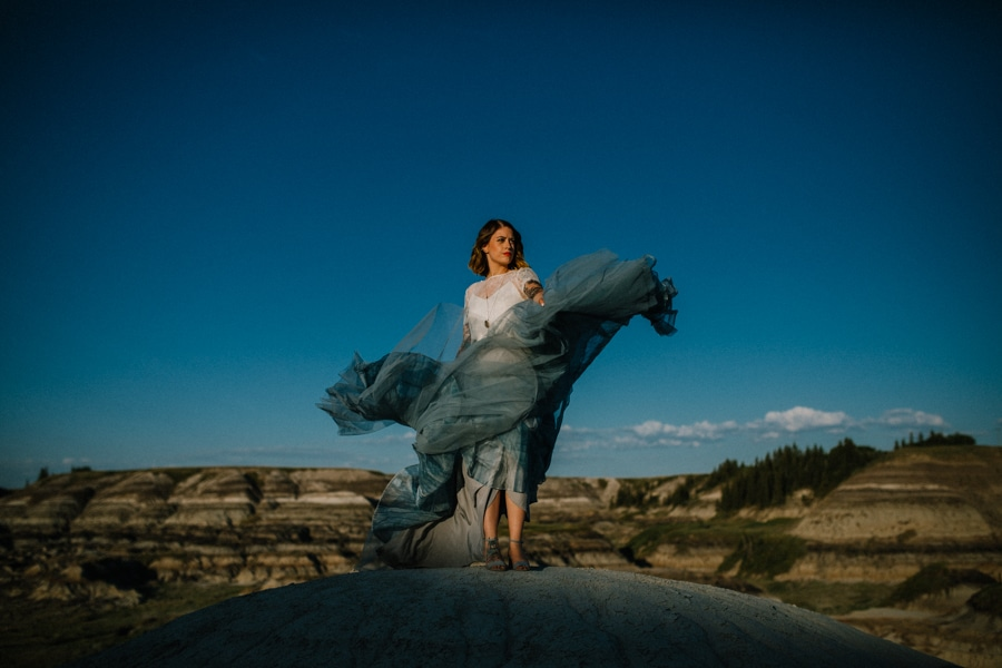 day after session in Drumheller alberta, bride is in a smokey blue wedding dress