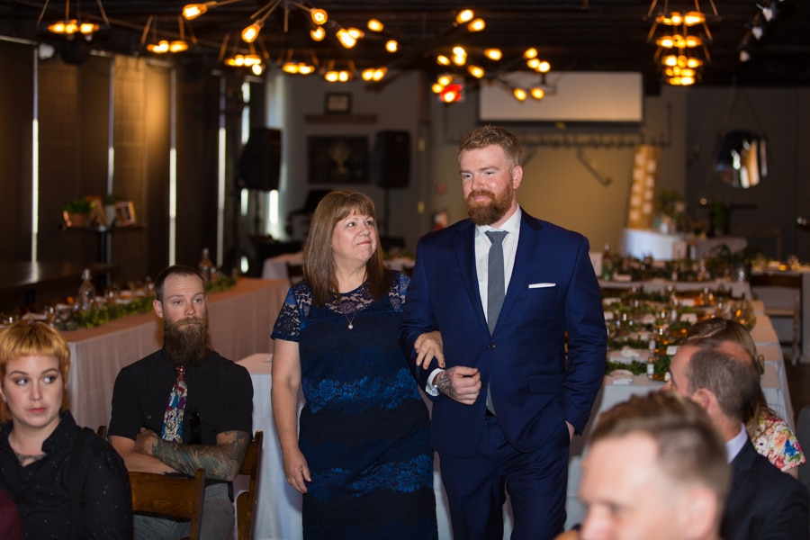 groom being walked down the aisle by his mother at The Baron, Calgary