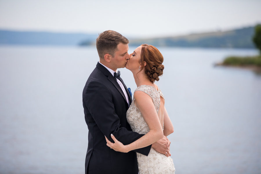 first look before the wedding at The Inverary Resort in Cape Breton, on a dock