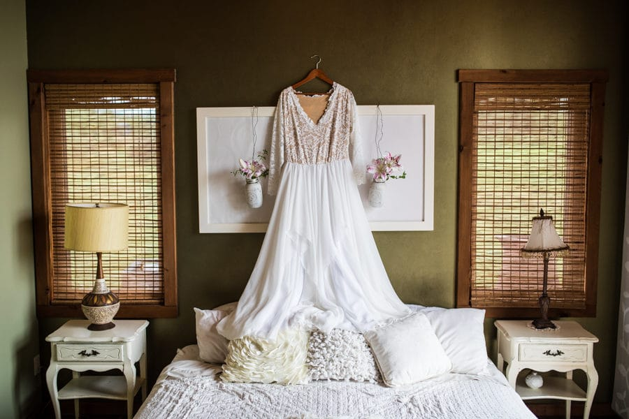 hanging up the dress in the cottage at woodland and wildflower wedding venue
