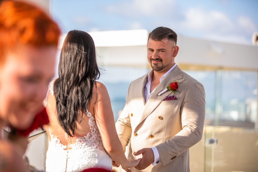 IBEROSTAR PLAYA MITA wedding - destination wedding photographer Cole Hofstra groom at the alter