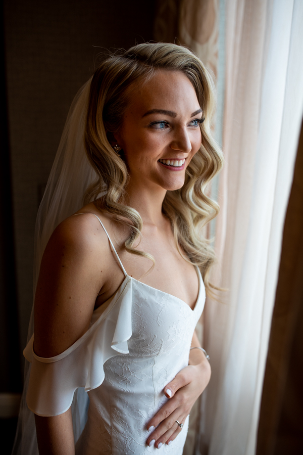 bride getting ready at Sheraton Suites Calgary Eau Claire