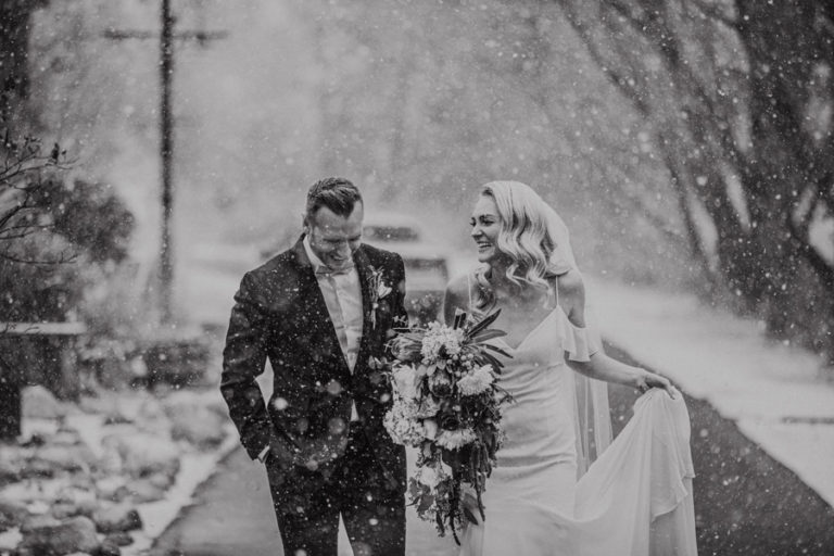 River cafe couple in the snow winter wedding gin Calgary