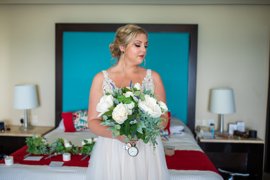 bride with flowers form the hotel