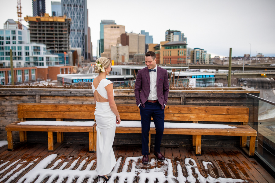 Couple doing first look on top of Charbar Calgary