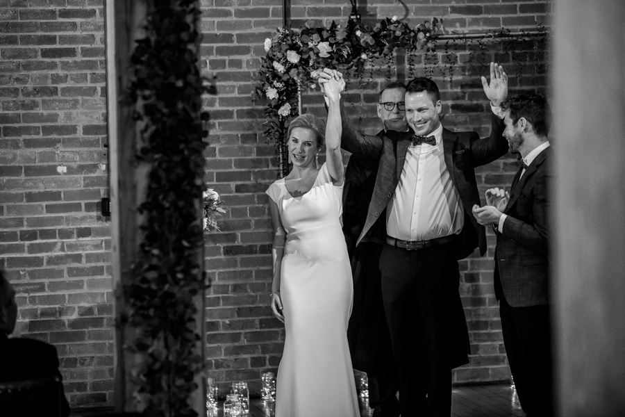 Bride and groom celebrate in Charbar Calgary wedding