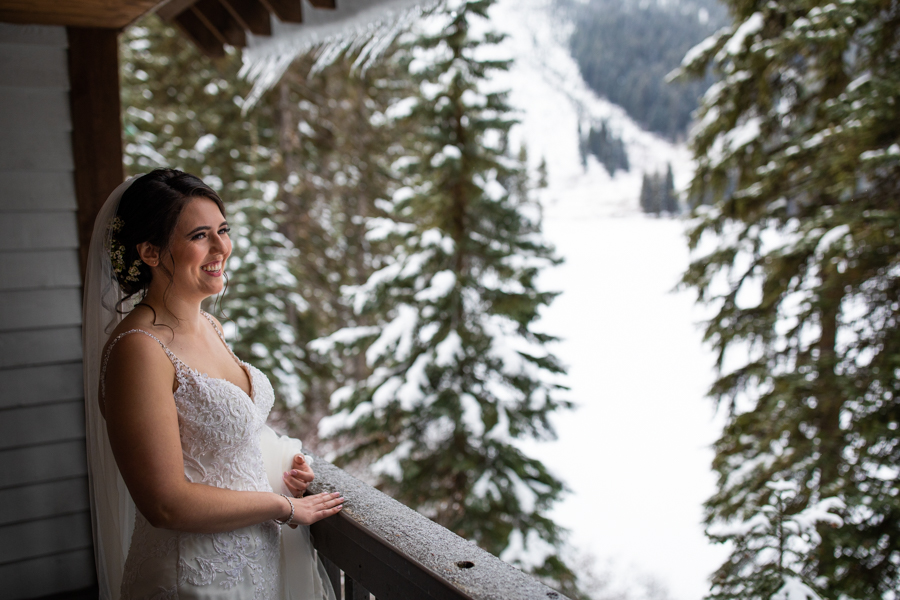 bride in her room at emerald lake lodge wedding