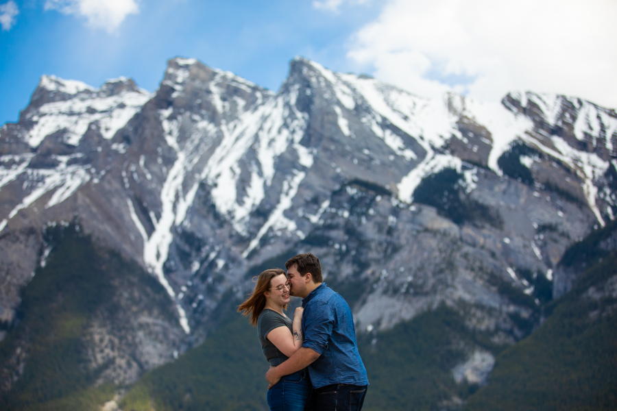 Lake Minnewanka couple kissing on the rock