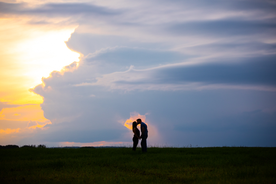 Amazing sunset with rustic country engagement session