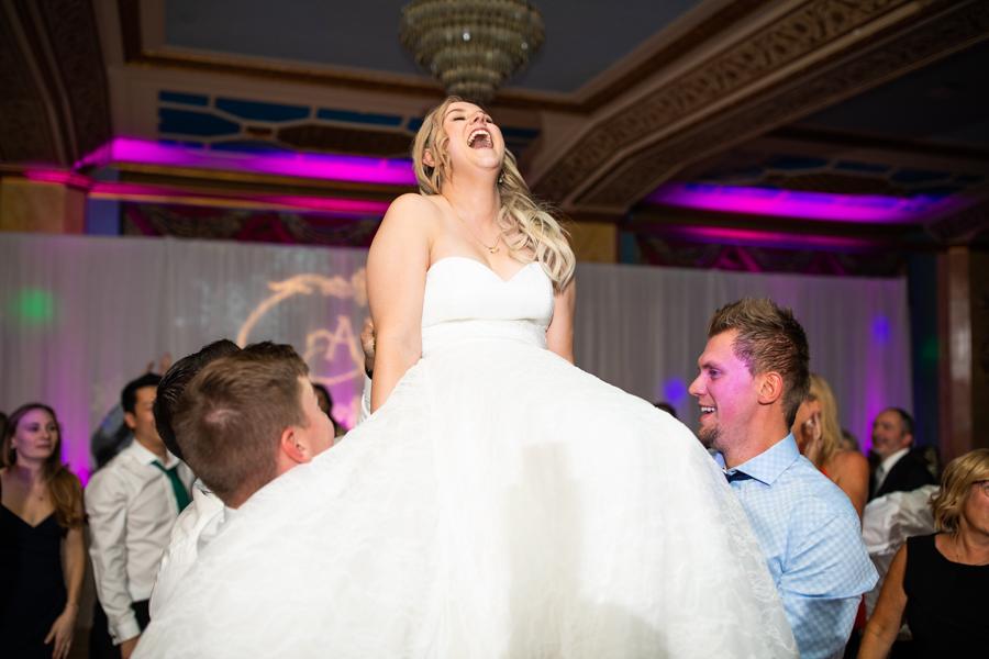 bride in a chair in the cascade ballroom