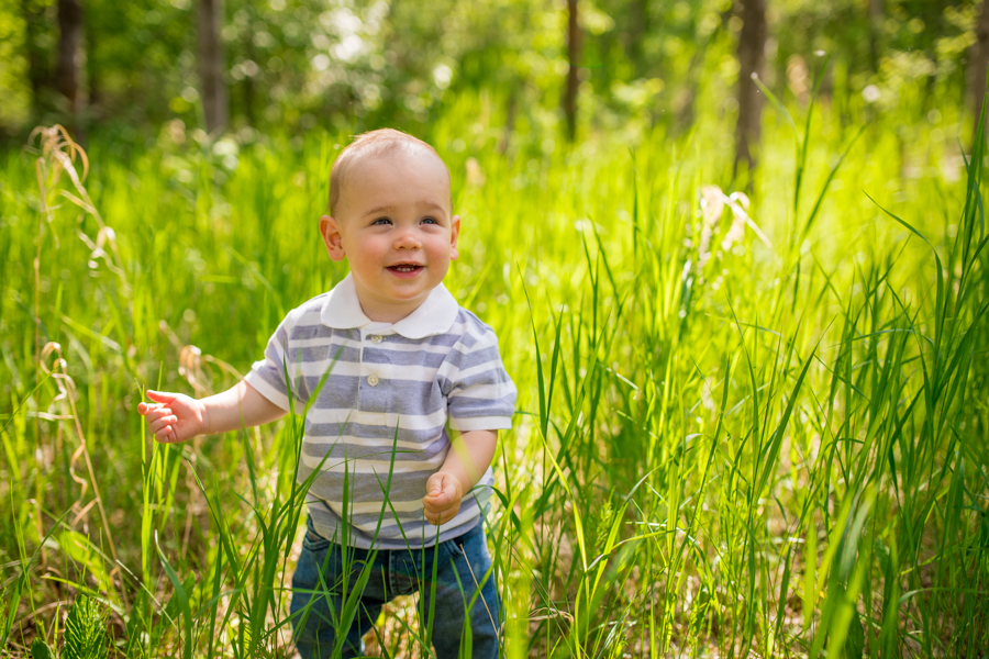 baby walking through the grass in Calgary park
