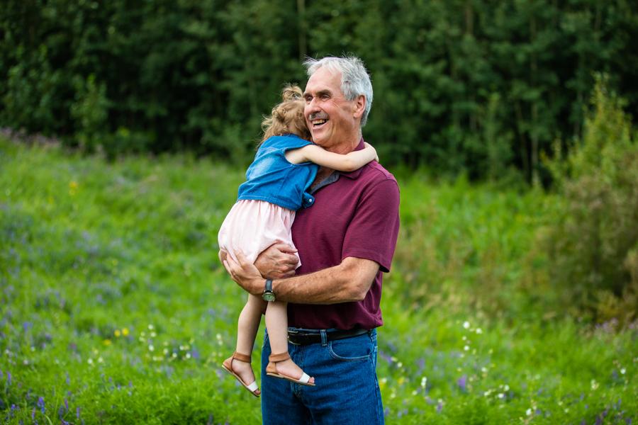 grandpa hugging granddaughter