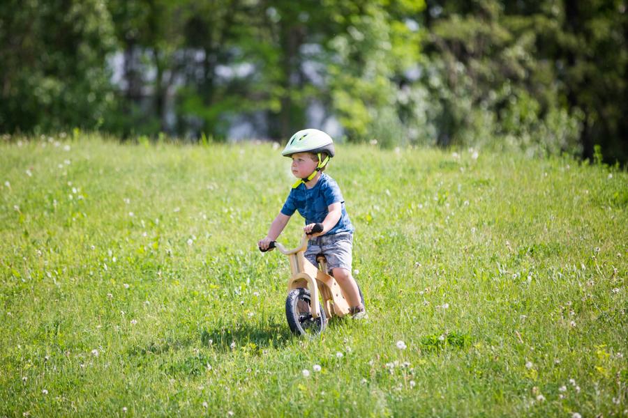 kid riding a bike eon a hill