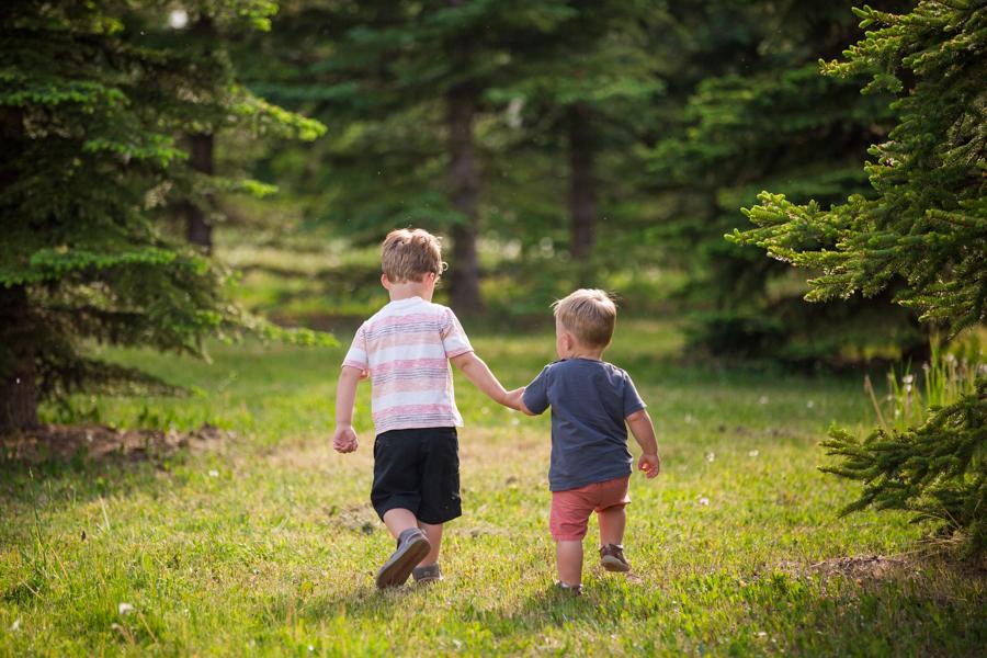 two boy walking int the field