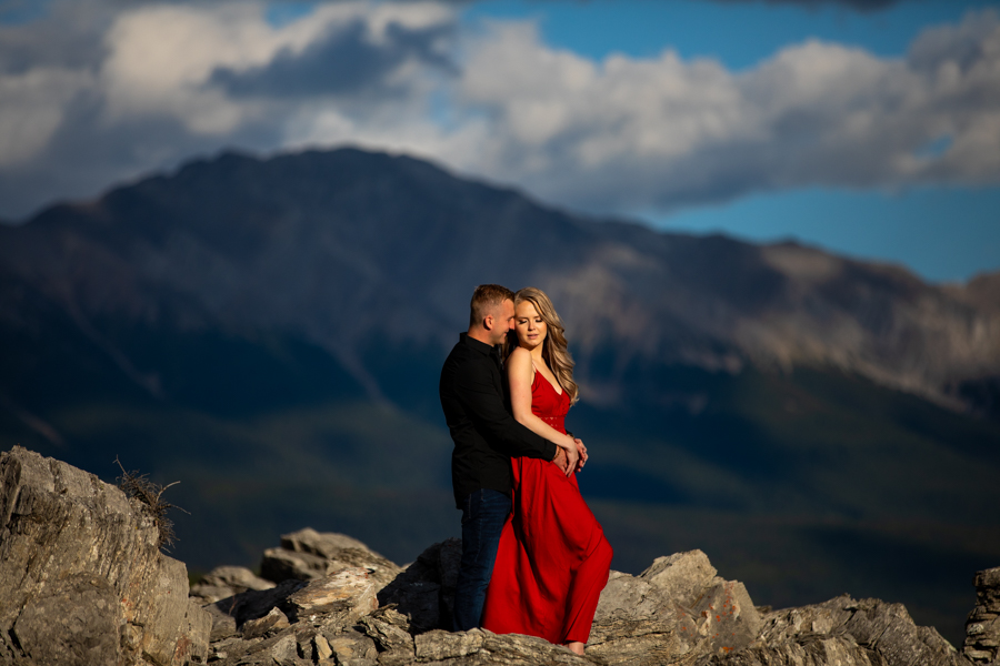 couple on a peak her in a red dress