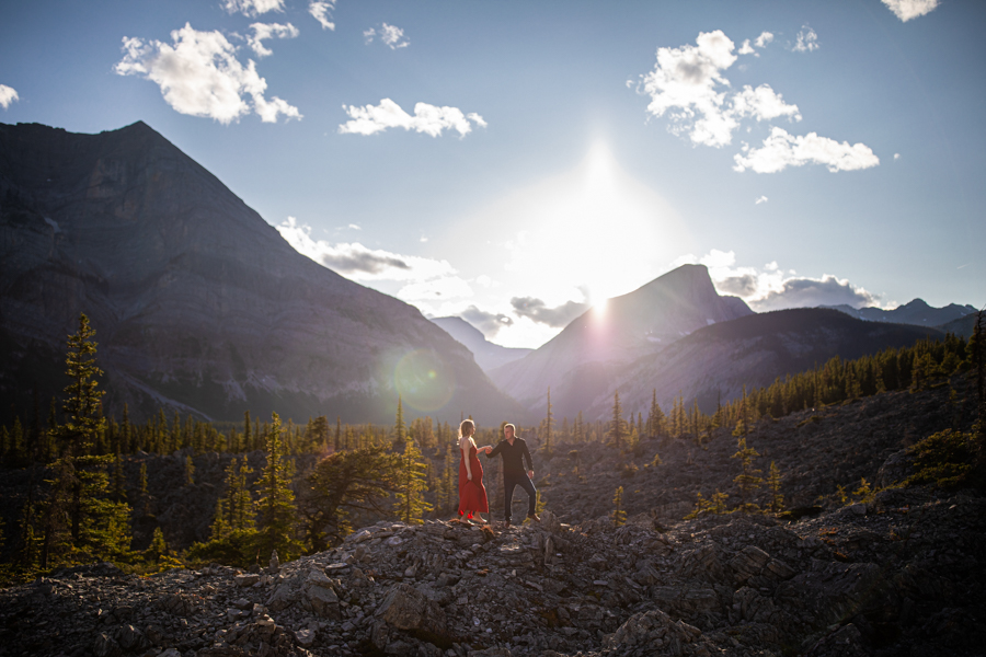 mountain engagement Kananaskis in a red dress