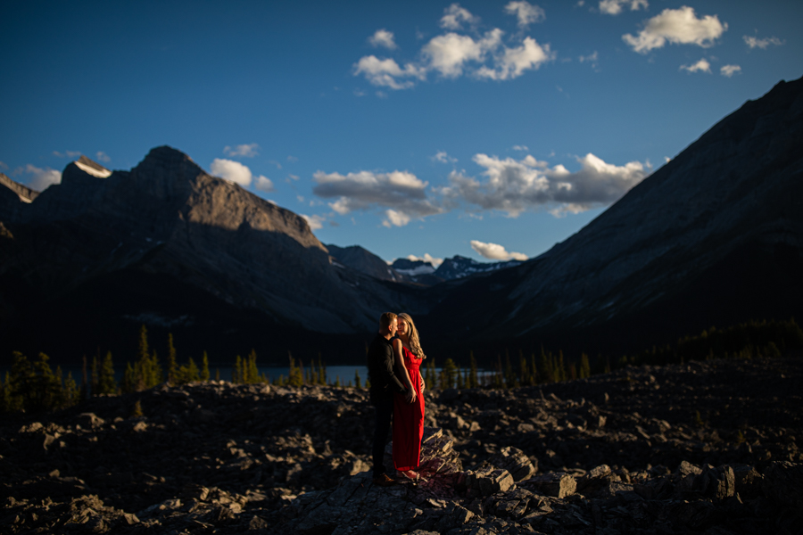 girl in a red dress in the mountains