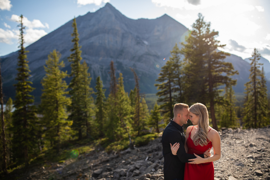 couple getting engagement photos in the mountains