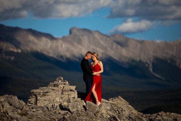 couple kissing on a peak