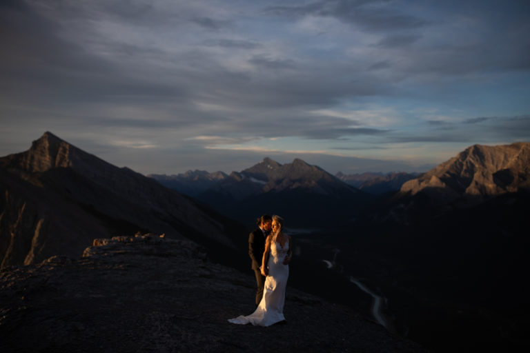 Couple on top of a mountain with a elopement photography