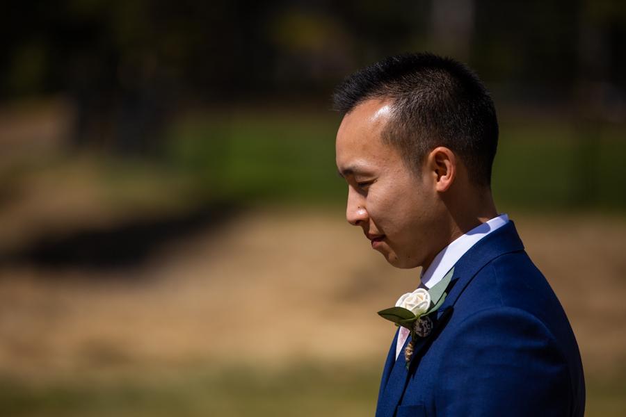 groom waiting for hi elopement ceremony to begin