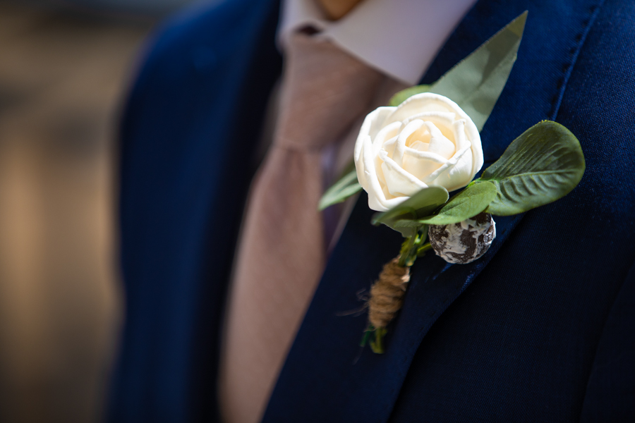 flowers on the grooms lapel