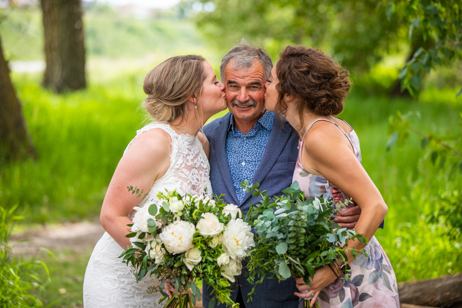 sisters give dad a kiss