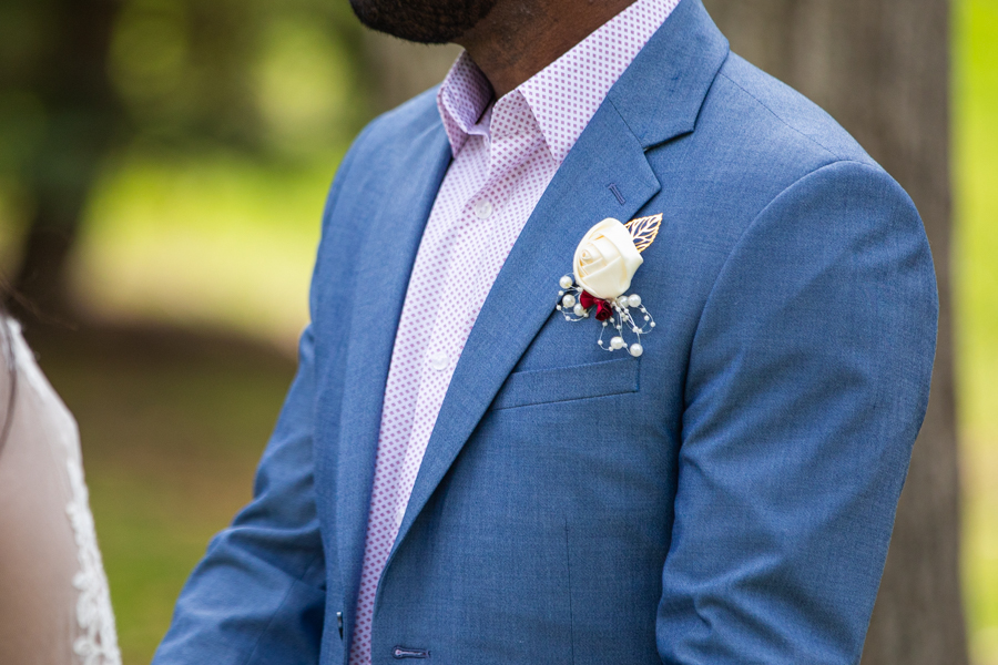 flower details on the grooms jacket