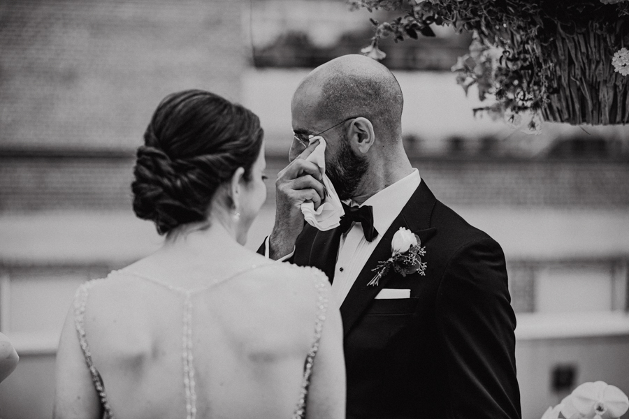 groom crying on a rooftop elopement in edmonton