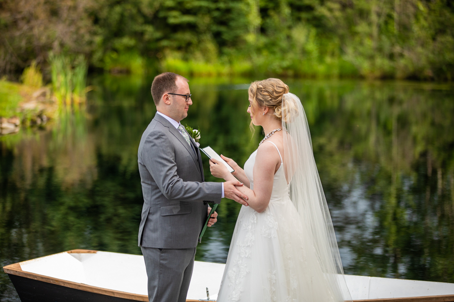 reading personal vows on a dock