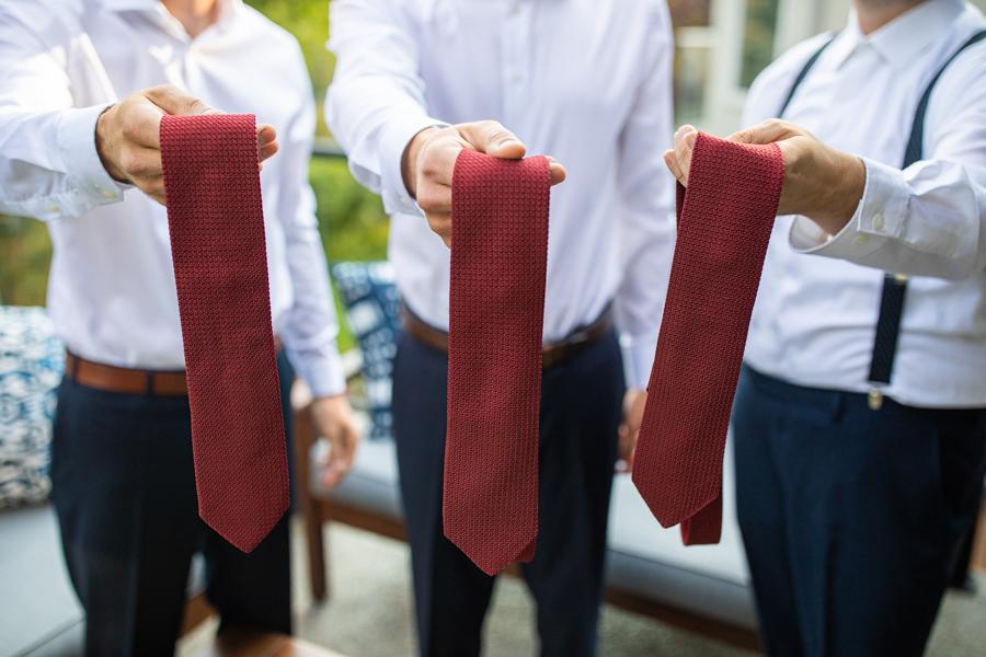 groom holding ties