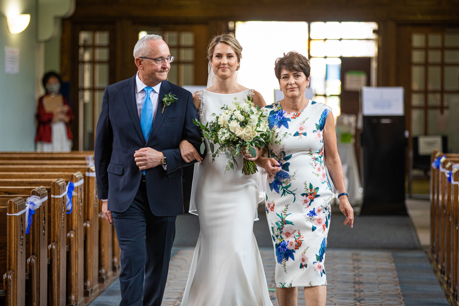 bride walking in with parents at St. Mary's Cathedral WEDDINGS