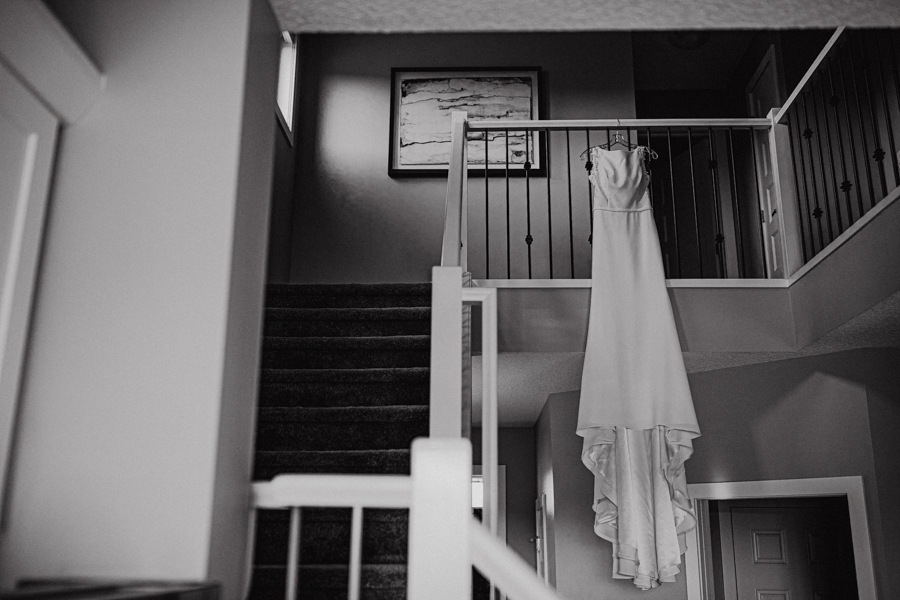 wedding dress hanging on a stairweel