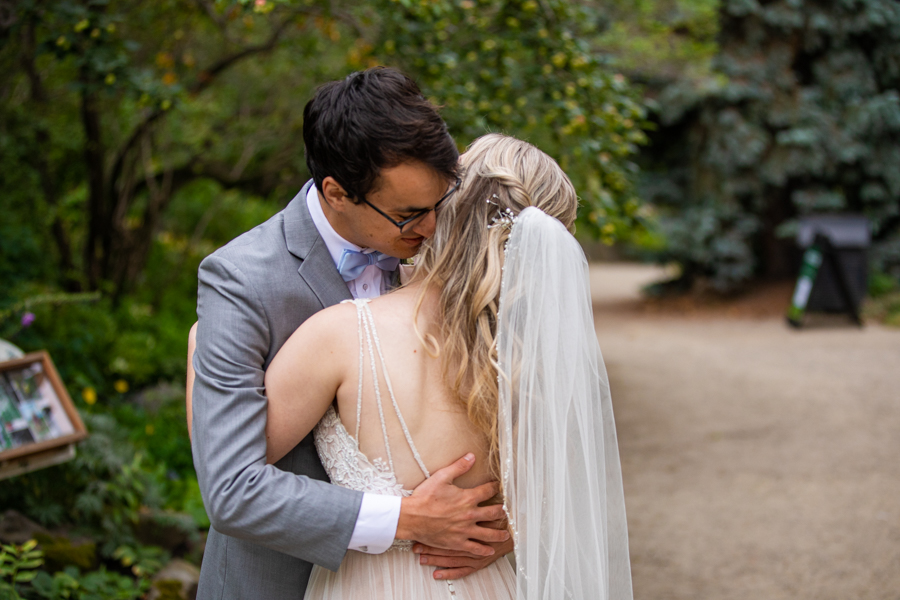FIRST LOOK HUG AT READER ROCK GARDEN WEDDING