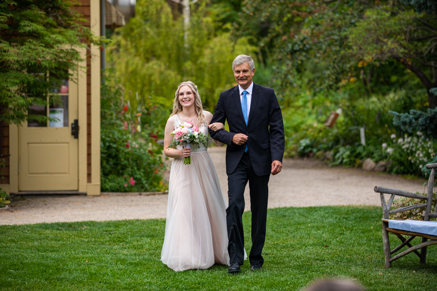 father daughter coming down the aisle reader rock garden