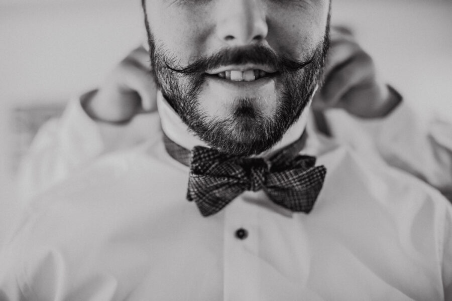groom with an amazing moustache