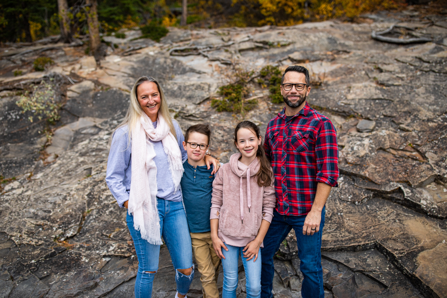 family of four in the mountains