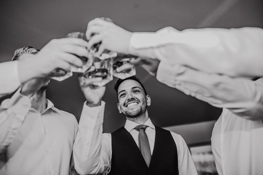 groom cheering wedding party