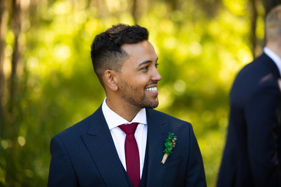 groom seeing his wife a bearspaw house wedding